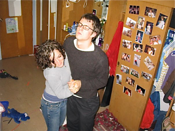 Cait and Kyle dancing in Cait's room upstairs